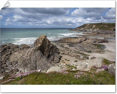 Overlooking the beach at Gunwalloe Church Cove Cornwall England on a sunny spring day, used in Poldard for night filming