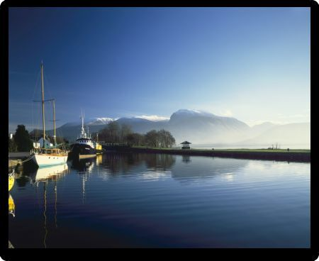 Boats on the Caledonian Canal nr Fort William Scotland, just below Ben Nevis on a cold day winter day  Dec 2005