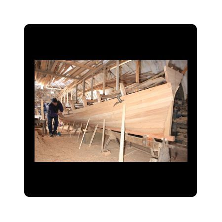 Dave Currah building a 32 ft long Racing Gig in his 34 ft long workshop at Looe in Cornwall, using planks of Elm wood. It takes Dave six month to build each gig, he has orders for the next two years