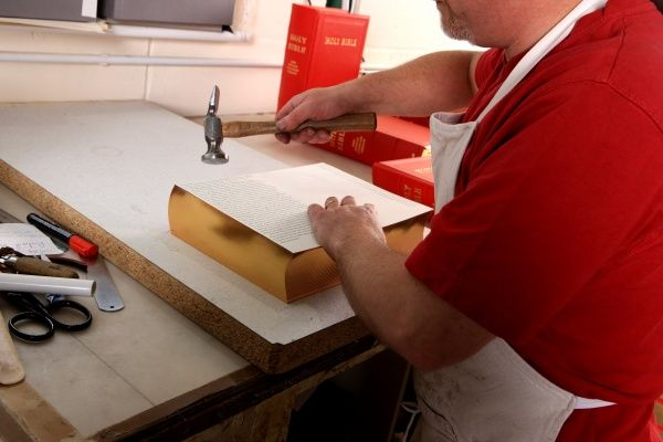 Bible's being bound at Ludlow Bookbinders in the Shropshire Town by craftman Phil Quallington