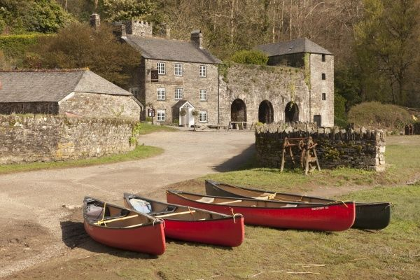 Canoe's lined up on the historic Quay at Cotehele beside the River Tamarnr Saltash in Cornwall