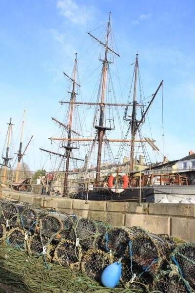 Tall ships in the harbour in the Cornish fishing port of Charlestown on the south coast