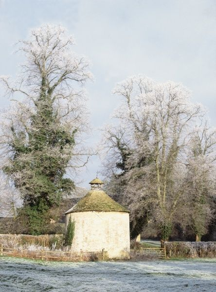 A stone Dovecote in the grounds of Cirencester Park in the Cotswolds on a winters day