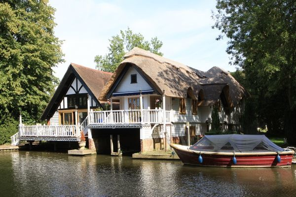 A picturesque thached Boathouse with a balcony beside the River Thames at Goring Berkshire