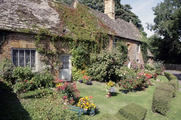 Gret Tew. Cottage garden in the Oxfordshire village of Great Tew on a summers day