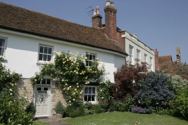A house with its garden beside the village Green at Haddenham Buckinghamshire