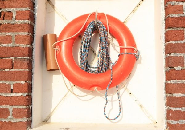 Life belt on the Quayside in the Cornish fishing port of Charlestown on the south coast