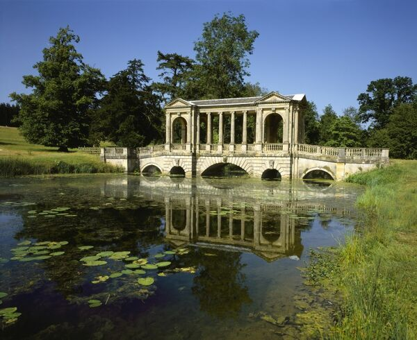 The Palladian Bridge in the Stowe Landscape Garden in Buckinghamshire on a summers afternoon