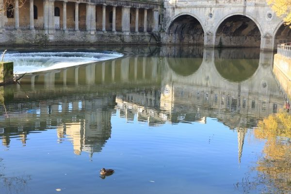 Reflections of Bath. Reflection of Pulteney Bridge in the River Avon with