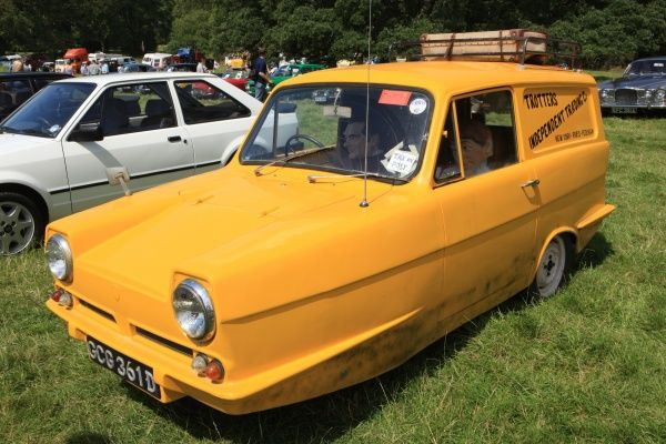 A Relliant Robin ( The Del Boy Car )at The Classic car show Boconnoc Estate near Lostwithiel Cornwall in August 2012
