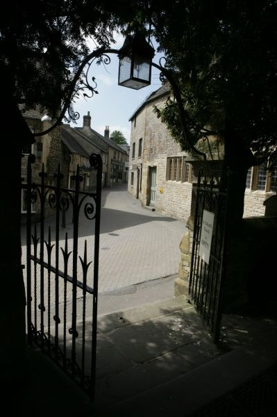 The gateway from the church yard in the cotswold town of Stow on the Wold Gloucestershire
